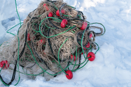 Catching fish with fishing net outdoor activities in winter time