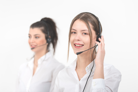 Female consulting manager with headset on light background 版權商用圖片 - 122817293