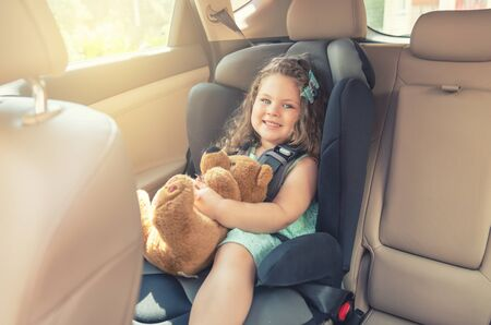 Cute little baby child sitting in car seat. Portrait of cute little baby child sitting in car seat.Safety concept
