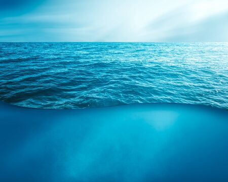 wavy sea water surface with sky and underwater . Stok Fotoğraf