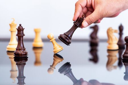 businessman plays chess, concept of business competition