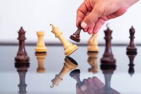 Businessman  in the chess game king is checkmated by pawn Banco de Imagens