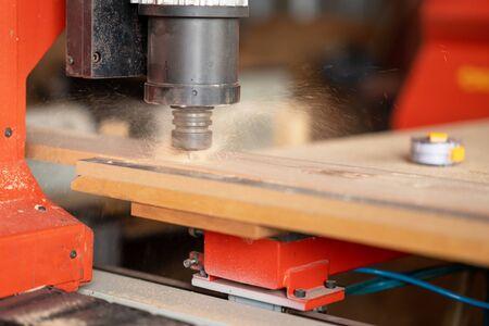 CNC Lathe machine working on wood to lathe and shaping.