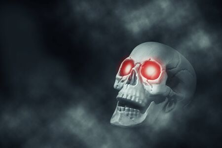 Skull with red eyes on isolated black background Stock Photo