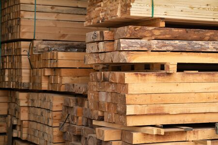 Satck of Timber are storaged in the wood warehouse.