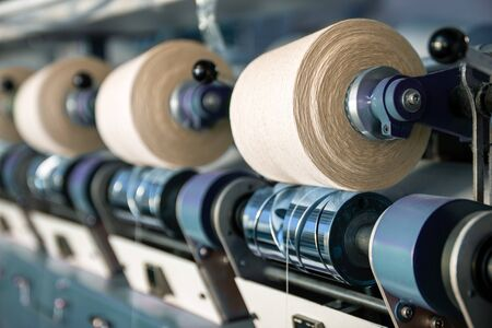 Interior of textile factory. Yarn manufacturing. Industrial concept. Stock Photo