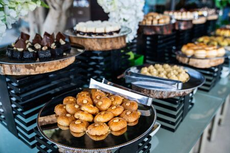A delicious dessert buffet with various sweet bakery in a restaurant or hotel.