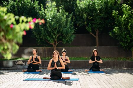 relaxation view on women face doing yoga in garden.
