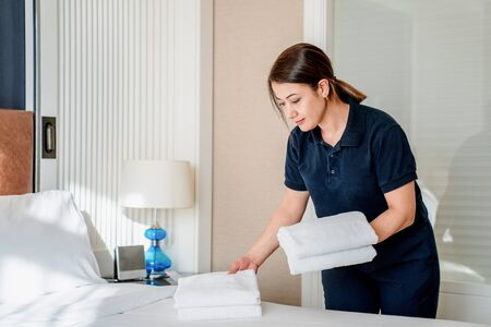 Maid clean the room and replace the bedsheets and towels.