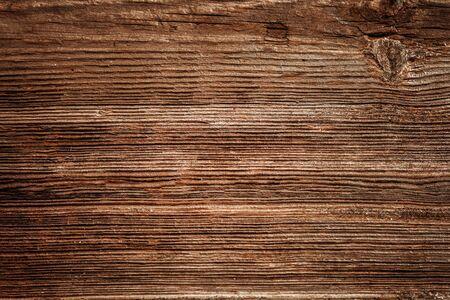 Brązowe, niepomalowane naturalne drewno z słojami dla tła i tekstury