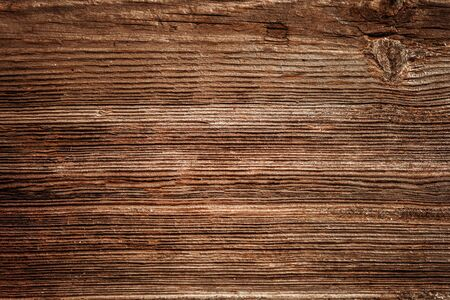 Brown unpainted natural wood with grains for background and texture