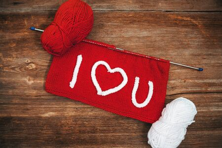 Writing I Love You on knitting with needlework. Valentines day concept Foto de archivo