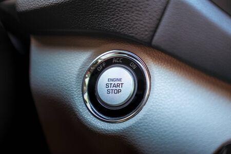 Start stop engine modern new technology car button, close up
