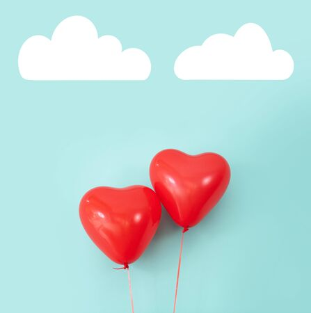 Two heart shaped red air baloon front of a font. Valentined day and romance concept