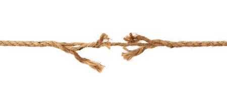 Long, old frayed rope is breaking off. Isolated on white Foto de archivo