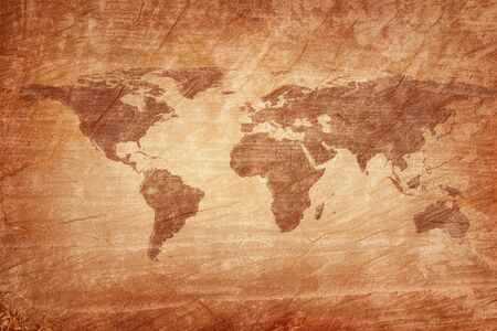 Old map of the world on a old wooden parchment background. Vintage style.