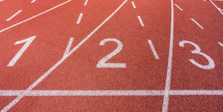 White painted lines and numbers on a running track in a athleticism and sports field. . High quality photo