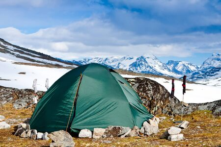 Tourists tent in the mountains on nice day Stock Photo