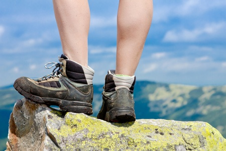 hiking boots on the rock in the mountains Stock Photo - 15266203