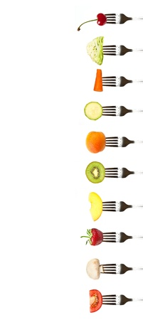 fruits and vegetables on the collection of forks with the place for your text. Diet and healthy eating concept