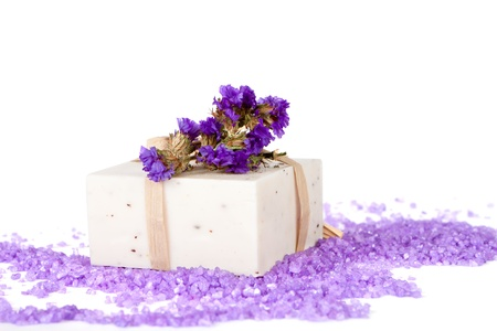 organic spa: Handmade Soap on a white background with violet flowers and salt bath