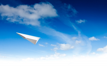 Paper planes in blue sky. Sky background photo