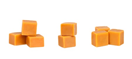 Different groups of caramel candy, isolated on a white background photo
