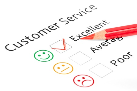 Tick placed in excellent check box on customer service satisfaction survey form photo