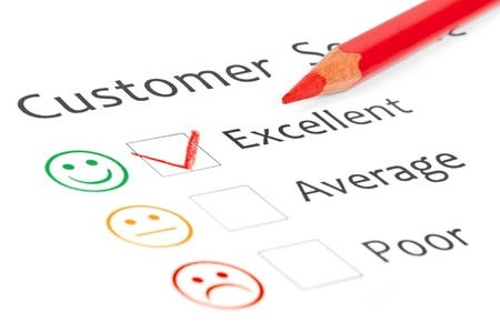 Tick placed in excellent check box on customer service satisfaction survey form Stock Photo - 15375999