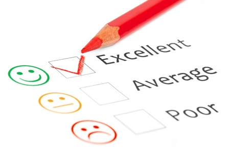 Tick placed in excellent check box on customer service satisfaction survey form Stock Photo - 15375993