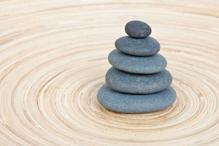 Stone tower on a wooden board Stock Photo - 15408144