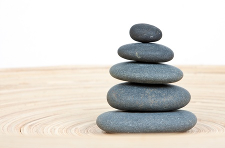 Stone tower on a wooden board Stock Photo - 15408137