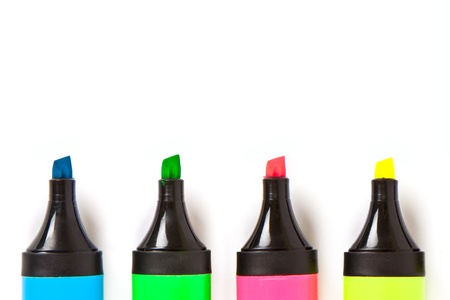 Colorful markers on a white background photo