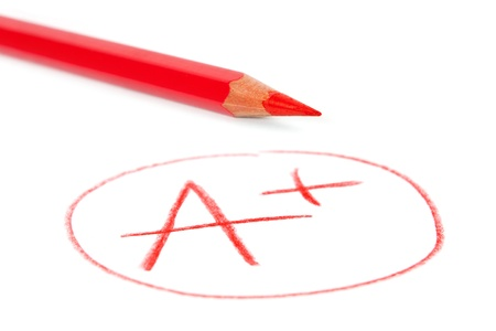 assignment: mark A+ with red pencil isolated on white