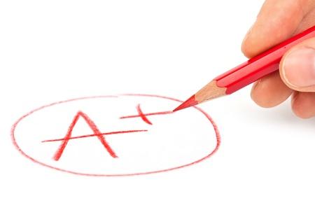 contrassegnare A + con la matita rossa isolato su bianco Archivio Fotografico