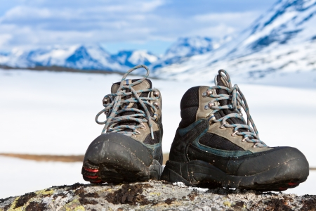 crampons: Climbing boots on the rock in the mountains Stock Photo