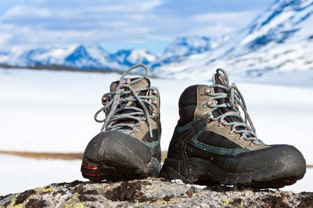 Climbing boots on the rock in the mountains Stock Photo