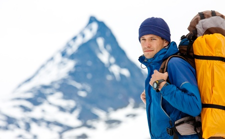 backpacking: Hiker in winter mountains Stock Photo