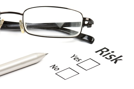 assessing: planning the business risk with pen at work Stock Photo