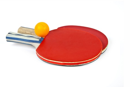 Table tennis rackets and ball on a white background  photo