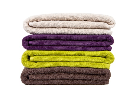 stacked colorful towels on a white background Stock Photo