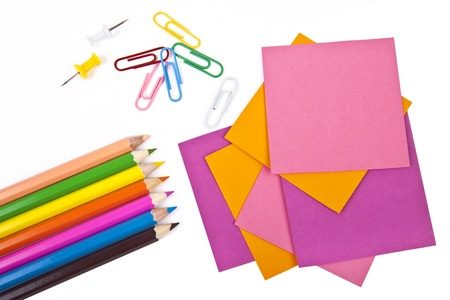 Colorful pencils and note papers on white Stock Photo