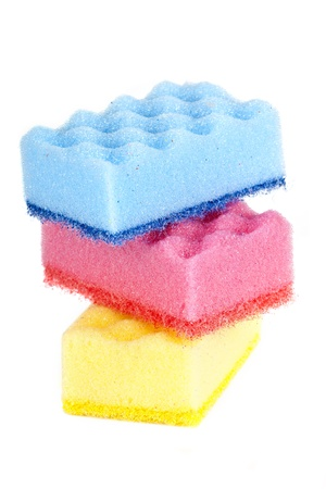 housecleaning: red, yellow, and blue sponge on a white background
