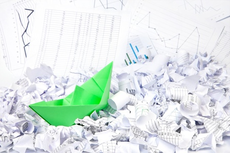 Business concept of paper boat and documents photo