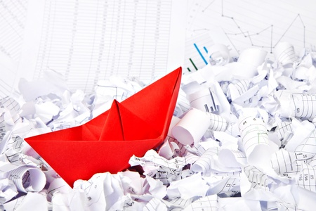 managing money: Business concept of paper boat and documents