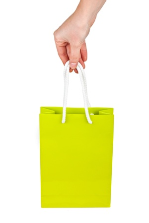 Hand with green bag isolated on white background  photo