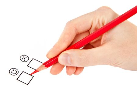 female hand with red pencil choosing yes or no Stock Photo - 15623880