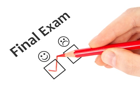 grades: Hand with red pencil estimate Final exam