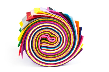colorful felt rolled up on white
