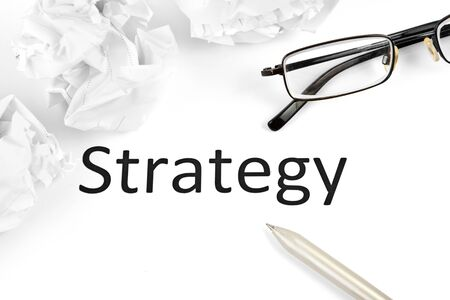 strategic focus: business or investment strategy concept with pen paper, notebook and glasses